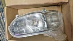 New Genuine Left hand Headlamp and Indicator Mk6 Escort with Headlamp Levelling LHD