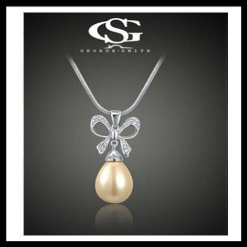 George Smith Crystal Bow and Large Pearl presented on Silver Plated Necklace