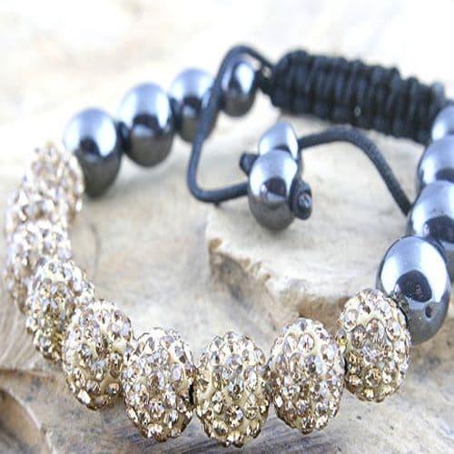 Shamballa Style Fashion Bracelet with nine facetted encrusted Gold Beads